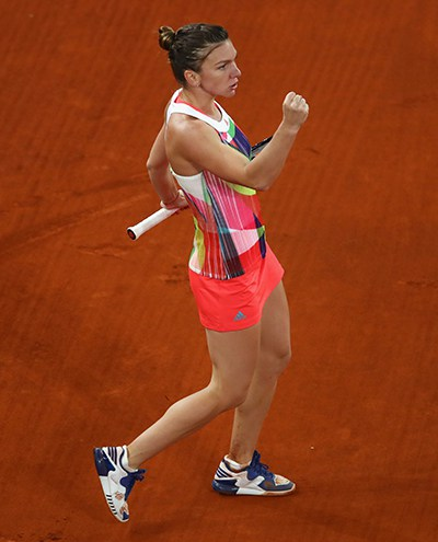MADRID, SPAIN - MAY 07:  Simona Halep of Romania celebrates a point against Dominika Cibulkova of Slovakia in the womens final during day eight of the Mutua Madrid Open tennis tournament at the Caja Magica  on May 07, 2016 in Madrid,Spain.  (Photo by Clive Brunskill/Getty Images)
